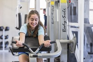 student using equipment at gym at alton campus
